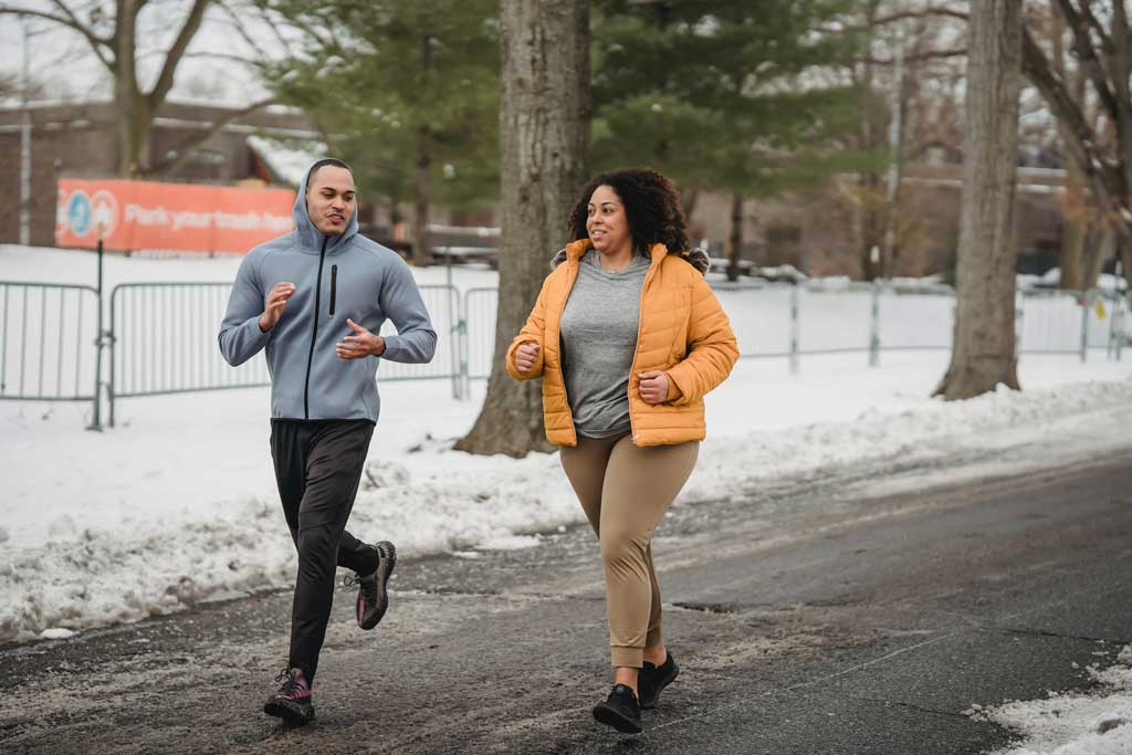 Coach and student running together